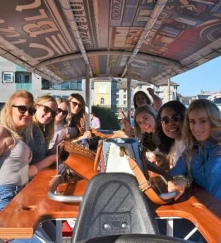 Image shows a group of Hens enjoying the Pedi Bus activity in Galway