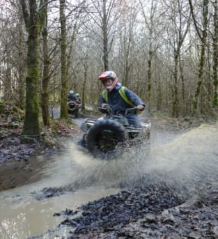 Image of a Quadbiking going through water