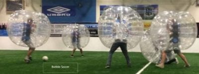 Image of 5 Bubble Balls during a game of Bubble Soccor for a Hen Party