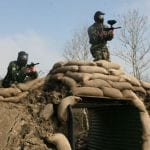 Image of 2 people on top of a bunker yielding Paintballing guns Hen party activity Carrick on Shannon