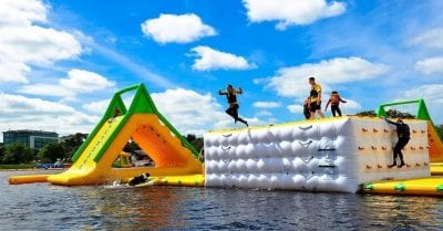 Image of 2 inflatables in Athlone with people jumping off into the water during a hen party