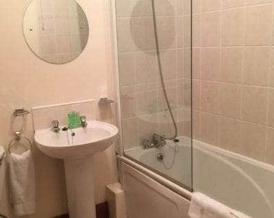 bathrooms with white tiles of self catering apartment in carrick on shannon for hen parties