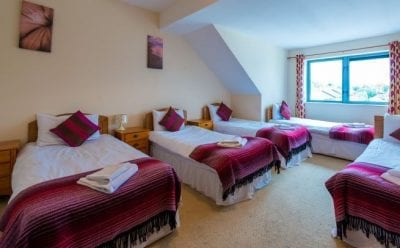 bedroom with 3 single beds in a self catering apartment in Carrick on shannon