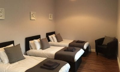 Bedroom in one of our self catering apartments for hen parties in carrick on shannon decorated in Greys